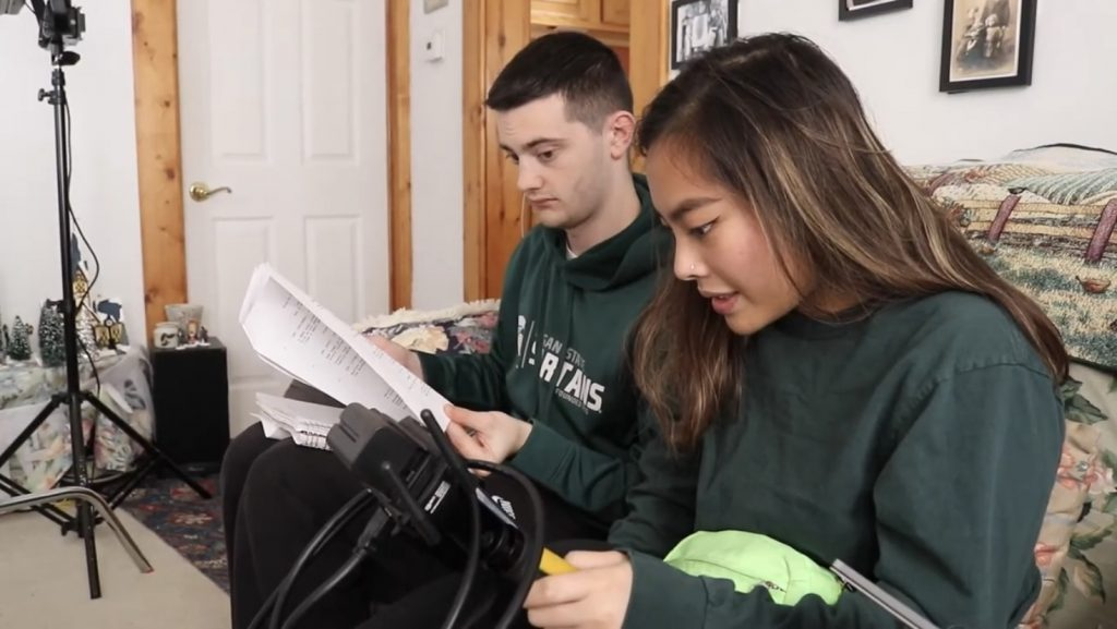 Nick Naranjo and Kristina Familara looking over the film script and some equipment