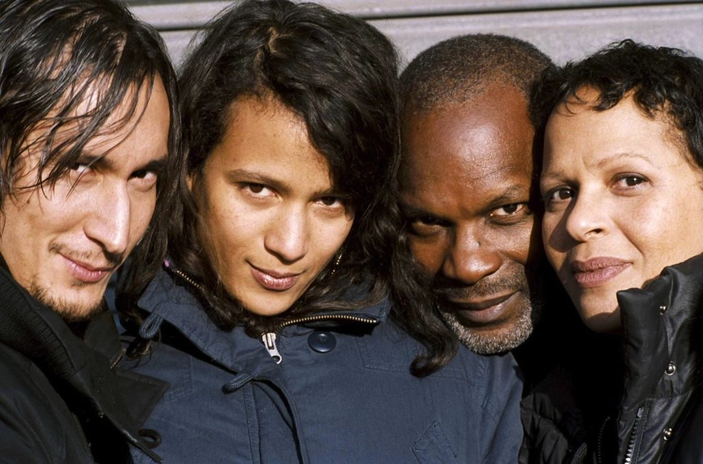 four people smiling at the camera