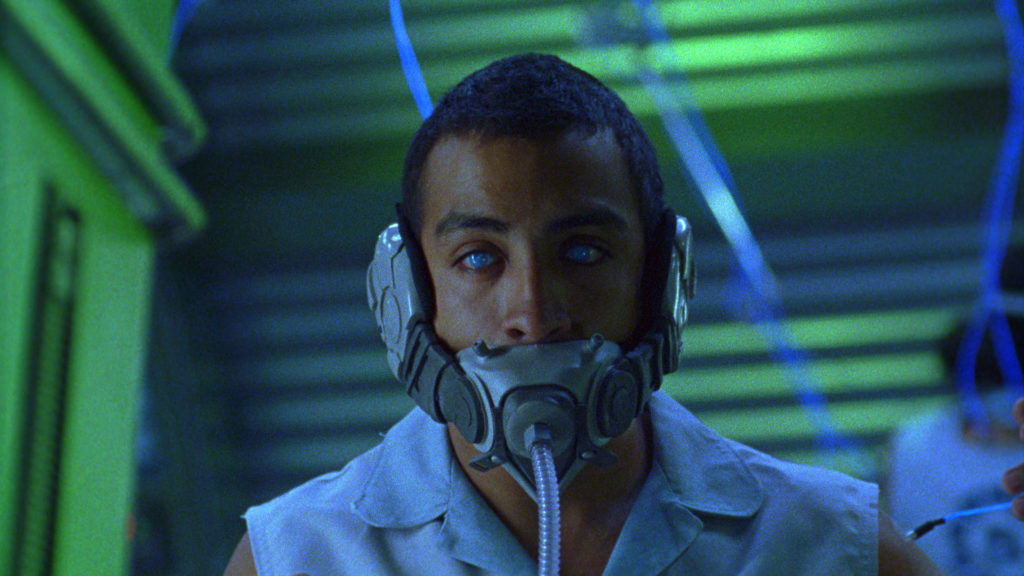 a man with a futuristic oxygen mask and translucent eyes